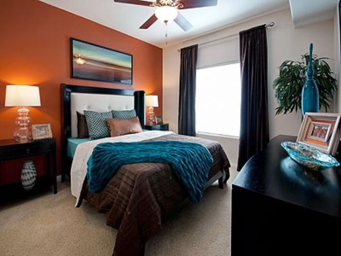 The Orange Accent Wall With Teal And Brown Bedding Is Burnt Bedroom