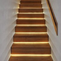 LED lighting under stairs. A much more modern look than ...