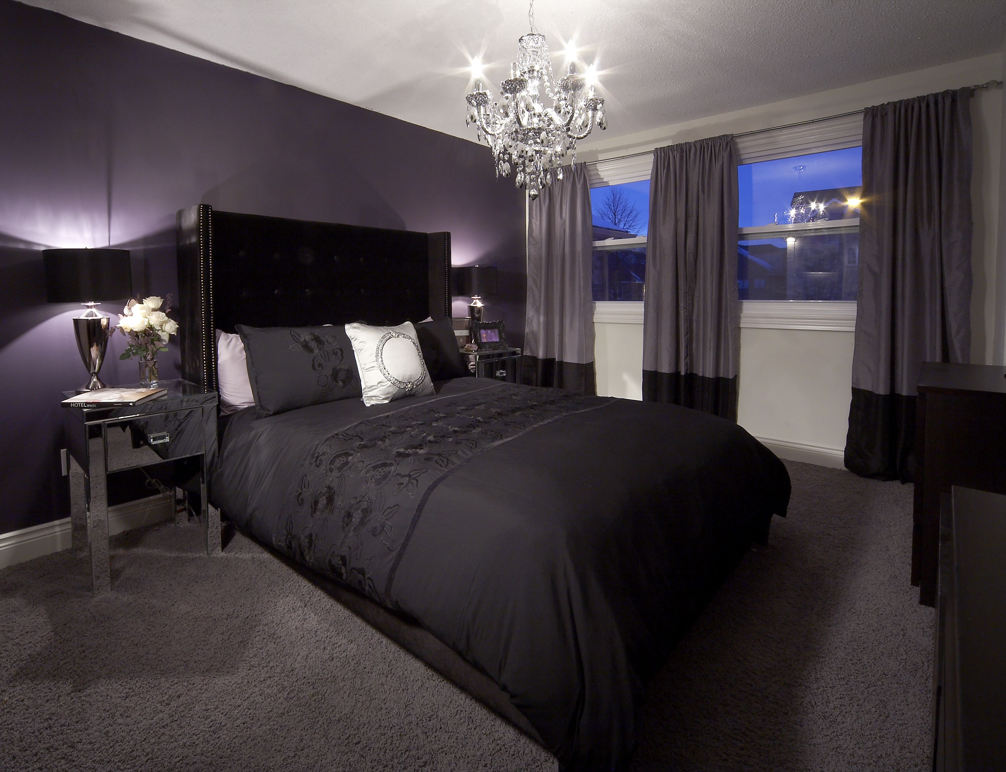 Bedroom with purple feature wall and drapery, crystal