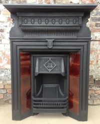 An original Edwardian antique cast iron fireplace with