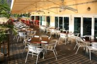 Great tropical outdoor restaurant setting with chairs ...