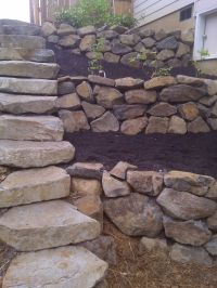 Rock retaining wall with stairs | Garden | Pinterest ...