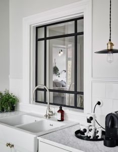 An internal window with black frames grey marble and industrial pendant lamp in the kitchen of  beautiful swedish home calm muted tones also fenetre verriere pinterest kitchens interiors rh