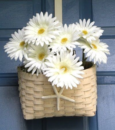Cute front door decoration for summer.  Id pick some much brighter flowers, but