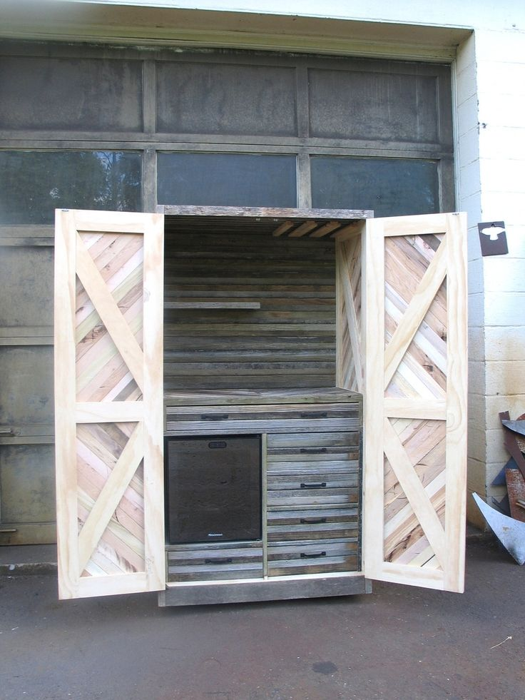 Reclaimed, pallet and barn wood, chevron liquor cabinet with a built-in wine fri