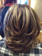 medium blonde highlighted hairstyle
