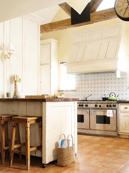 love the wood (butcher block?) counters in this kitchen.