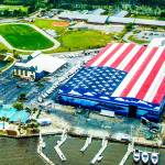 A massive American flag painted on the roof of the boat storage building at Legendary Marine in Destin, Florida