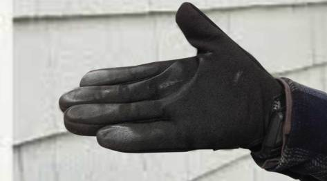 white aluminum oxide visible on a black gloved hand