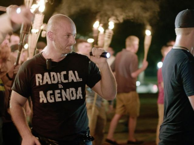 PHOTO: Christopher Cantwell attends a white nationalist rally in Charlottesville, Va., Aug. 11, 2017.