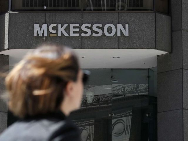 PHOTO: A pedestrian passes a McKesson sign on an office building in San Francisco.