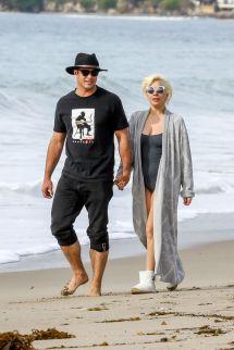 Taylor Kinney And Lady Gaga Walk Beach