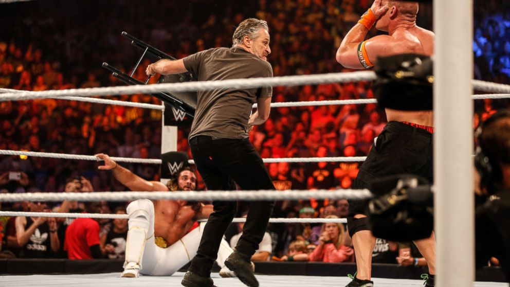 steel chair in wwe chairs with cane seats jon stewart hits good guy john cena at s summerslam the former daily show host found himself role of villain