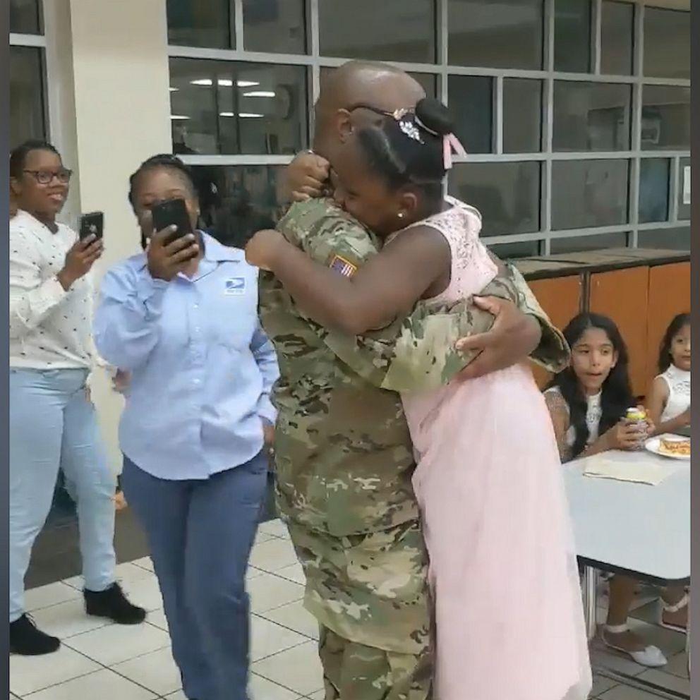 deployed dad surprises daughter