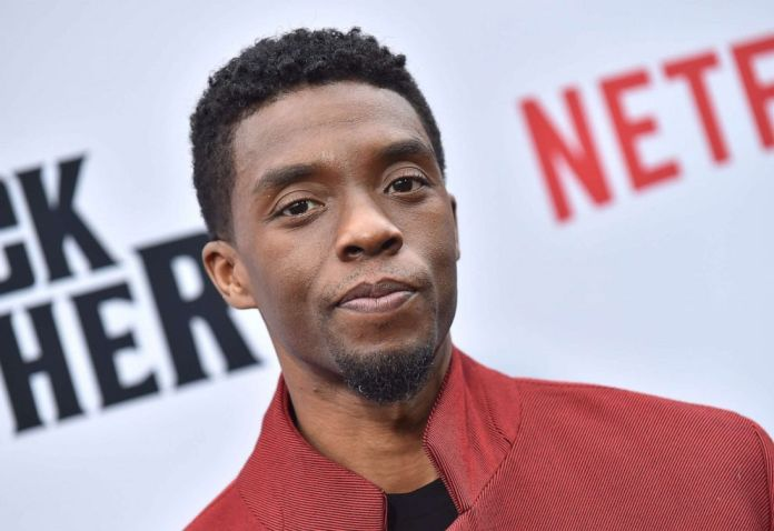 "PHOTO: In this file photo taken on June 3, 2019, actor Chadwick Boseman attends Netflix's ""The Black Godfather"" premiere at Paramount Studios Theatre in Los Angeles."