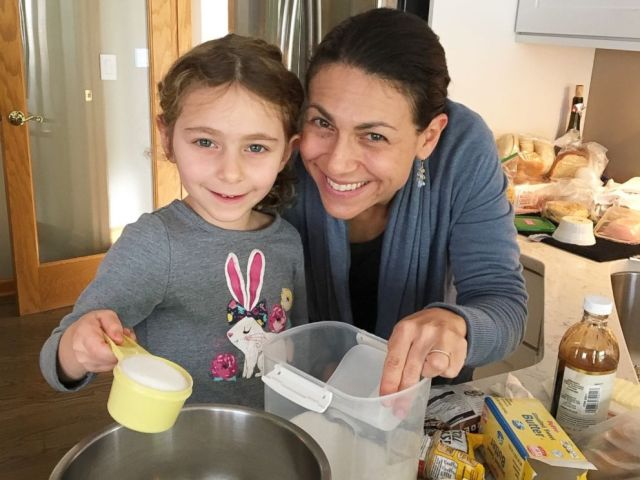 PHOTO: Elisa Strauss and her daughter preparing to make cookies.