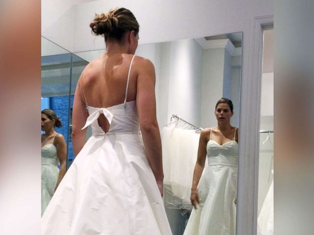 PHOTO: Lanie Parr, of New York City, tries on a wedding dress at the end of GMA Train My Way.