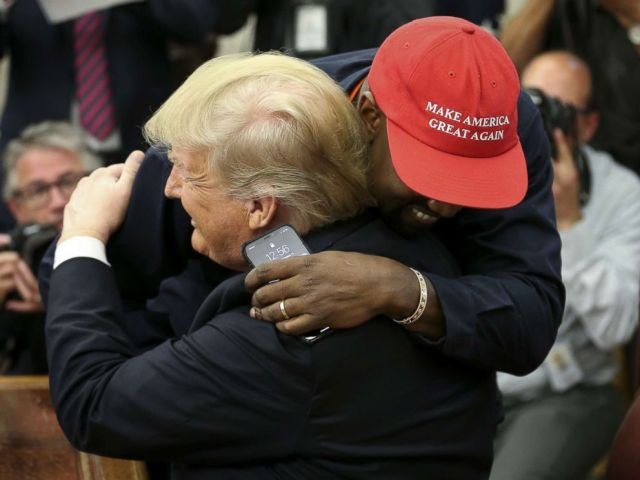 PHOTO: President Donald Trump embraces rapper Kanye West at a meeting at the White House Oval Office on October 11, 2018.