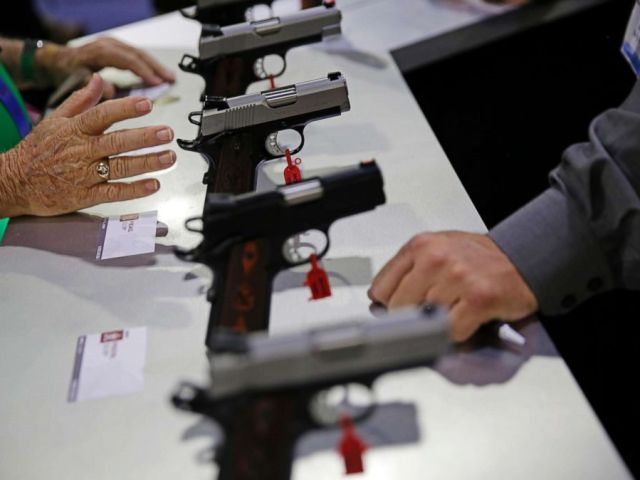 PHOTO: Guns sit on display at the NRA annual convention where President Donald Trump is scheduled to speak later in the day in Atlanta, Friday, April 28, 2017.