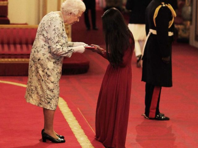PHOTO: Miss Suhani Jalota from India receives a Queens Young Leaders Award for 2017 from Queen Elizabeth II at the 2017 Queens Young Leaders Awards Ceremony at Buckingham Palace, June 29, 2017 in London.