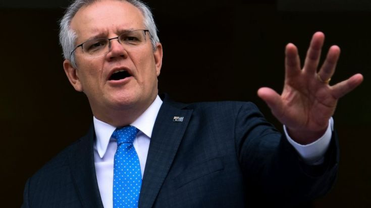 Australian Prime Minister Scott Morrison speaks to the media during a press conference at Parliament House in Canberra, Thursday, Sept. 9, 2021. The government confirmed it refused to allow climate change goals to be written into a proposed free trad