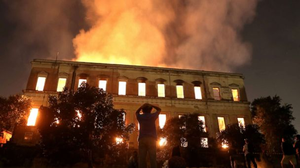 PHOTO: People watch as a fire burns at the National Museum of Brazil in Rio de Janeiro, Sept. 2, 2018. (Ricardo Moraes /Reuters)
