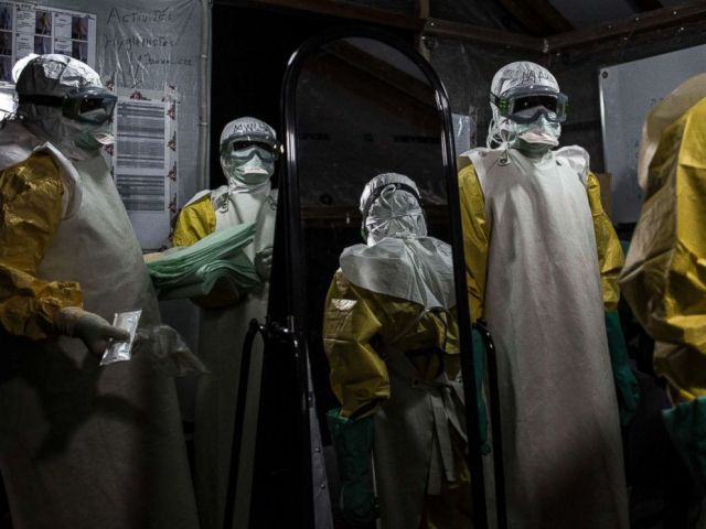 PHOTO: Health workers are seen putting on their personal protective equipment before entering the red zone of a Medecins Sans Frontieres supported Ebola treatment center in Butembo, Congo, Nov. 3, 2018.
