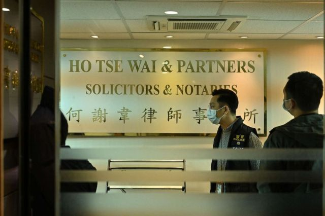 PHOTO: Police are seen inside the office of the law firm Ho, Tse, Wai & Partners in Hong Kong on Jan. 6, 2020, after dozens of pro-democracy figures were arrested under a controversial national security law.