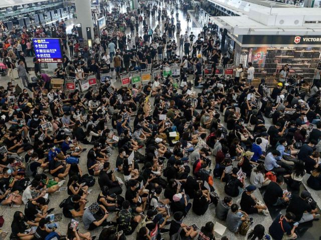 PHOTO: Hong Kong protesters block access to the departure gates during another demonstration at Hong Kongs international airport on Aug. 13, 2019.