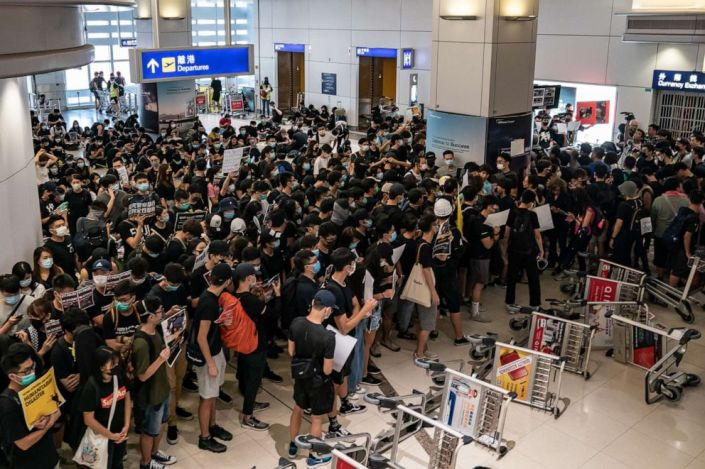 PHOTO: Protesters block the departure gate of the Hong Kong International Airport Terminal 2 during a demonstration, Aug. 13, 2019, in Hong Kong.