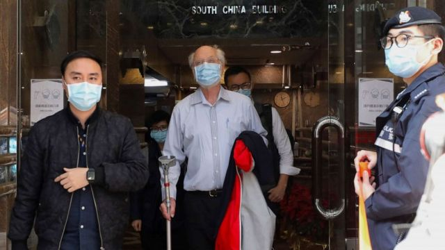 PHOTO: American human rights lawyer John Clancey, center, is arrested by police in Hong Kong on Jan. 6, 2021.
