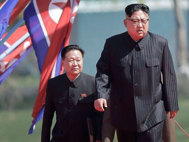 PHOTO: North Korean leader Kim Jong Un, right, and Choe Ryong Hae, vice-chairman of the central committee of the Workers Party, arrive for the official opening of the Ryomyong residential area, April 13, 2017, in Pyongyang, North Korea.