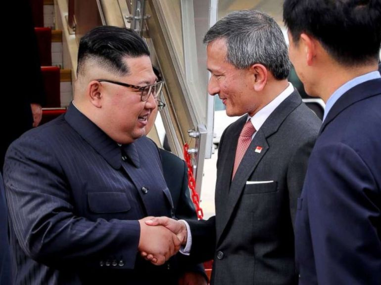 Kim Jong Un is greeted by Singapores minister for foreign affairs, Vivian Balakrishnan, upon landing in the city-state on Sunday, June 10, 2018.