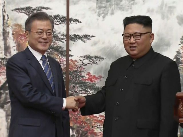 In this image made from video provided by Korea Broadcasting System, North Korean leader Kim Jong Un, right, and South Korean President Moon Jae-in shake hands at the end of their press conference in Pyongyang, North Korea Wednesday, Sept. 19, 2018.