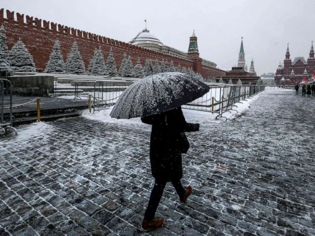 PHOTO: A woman walks on Red Square past the Kremlin after a night of heavy snowfall in Moscow, Dec. 6, 2018.