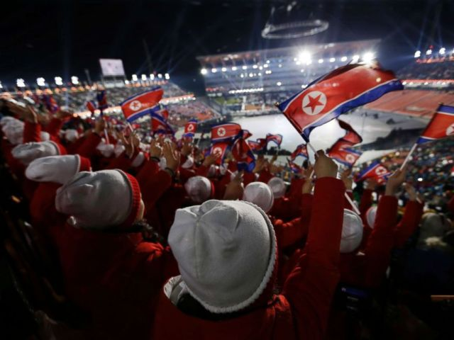 PHOTO: Members of the North Korean delegation wave flags as they wait for the Opening ceremonies to begin for the 2018 Winter Olympics in Pyeongchang, South Korea, Feb. 9, 2018.