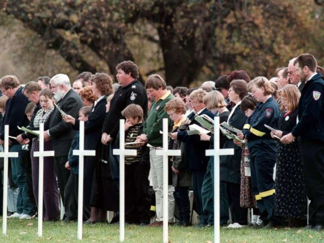 PHOTO: People pay their respects at the memorial service held at the Port Arthur historic site for the 35 victims of the Port Arthur massacre, May 19, 1996.