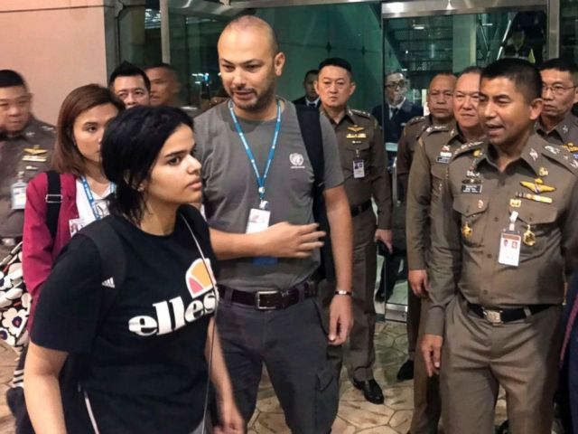 PHOTO: In this Jan. 7, 2019, file photo released by the Immigration Bureau, Saudi woman Rahaf Mohammed Alqunun, foreground, walks by Chief of Immigration Police Maj. Gen. Surachate Hakparn, right, before leaving the Suvarnabhumi Airport in Bangkok.