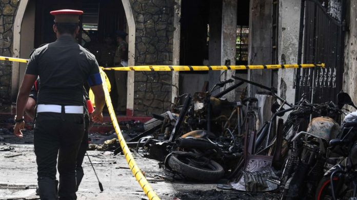 The Sri Lankan security guard passes the ruins of the Zion Church on April 21, 2019 after an explosion in Batticaloa, Sri Lanka.