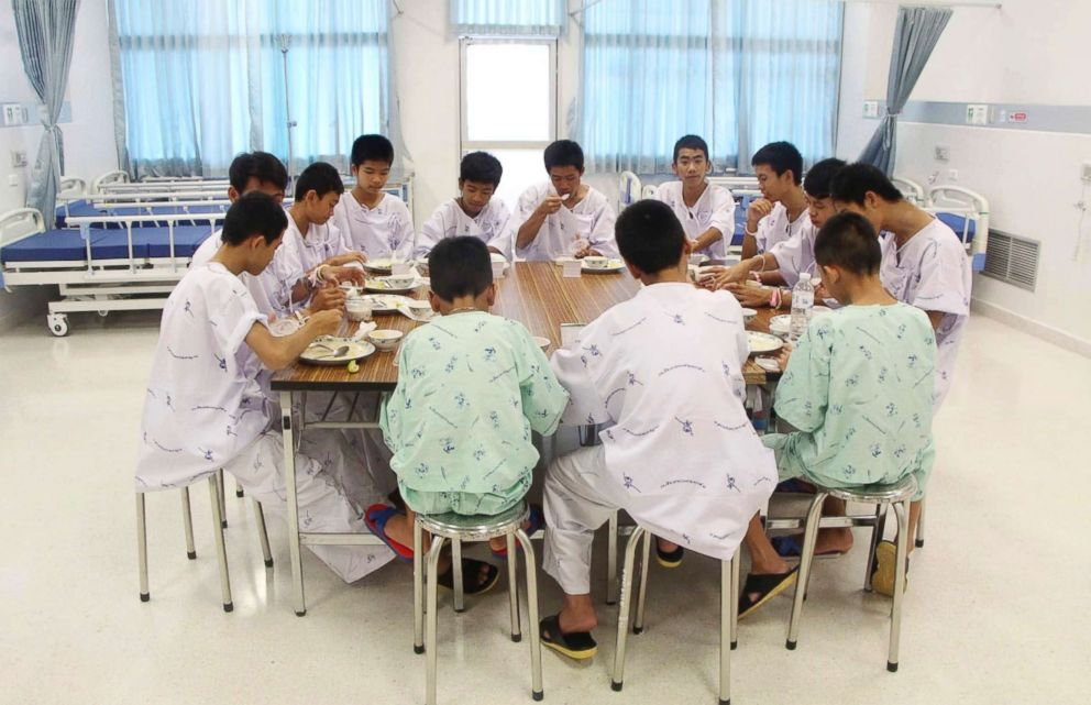 PHOTO: Some of the rescued soccer team members eat a meal together at a hospital in Chiang Rai, northern Thailand, July 15, 2018.