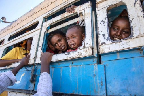 PHOTO: Tigray refugees who fled the conflict in the Ethiopia's Tigray region ride a bus going to a temporary shelter near the Sudan-Ethiopia border, in Hamdayet, eastern Sudan, Dec. 1, 2020.