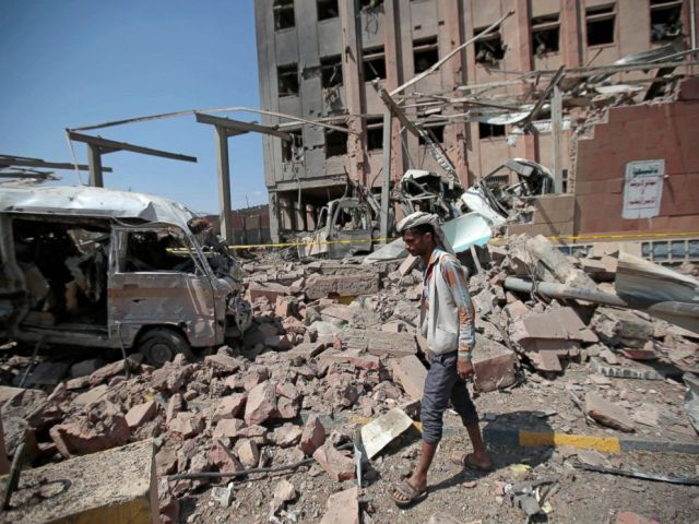 PHOTO: In this Feb. 4, 2018, file photo, a man inspects rubble after a Saudi-led coalition airstrike in Sanaa, Yemen.