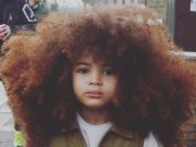big-haired little boy earns internet