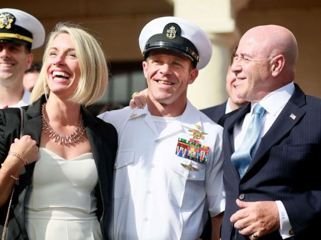 PHOTO: Navy Special Operations Chief Edward Gallagher celebrates with his wife Andrea after being acquitted of premeditated murder at Naval Base San Diego. July 2, 2019, in San Diego, Calif.