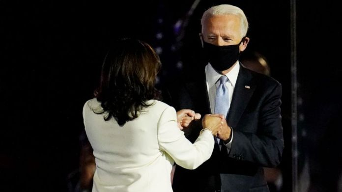 PHOTO: President-elect Joe Biden is greeted on stage by Vice President-elect Kamala Harris before he speaks in Wilmington, Del., Saturday, Nov. 7, 2020.
