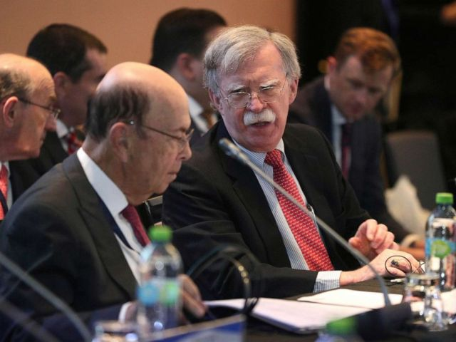 PHOTO: National security adviser John Bolton, right, speaks with U.S. Commerce Secretary Wilbur Ross during a conference of more than 50 nations that largely support opposition leader Juan Guaido in Lima, Peru, Aug. 6, 2019.