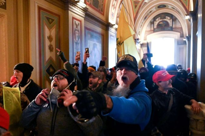 PHOTO: Supporters of US President Donald Trump protest inside the US Capitol on January 6, 2021, in Washington, DC. Demonstrators breeched security and entered the Capitol as Congress debated the a 2020 presidential election Electoral Vote Certification.