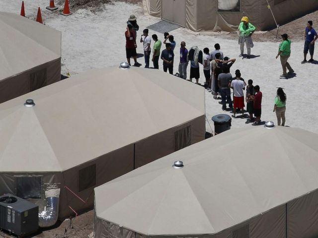PHOTO: Children and workers are seen at a tent encampment recently built near the Tornillo Port of Entry on June 19, 2018 in Tornillo, Texas.