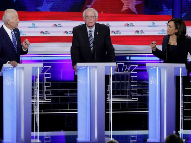 PHOTO: Former Vice President Joe Biden and Senator Kamala Harris debate as Senator Bernie Sanders listens during the second night of the first U.S. Democratic presidential candidates 2020 election debate in Miami, Fla., June 27, 2019.