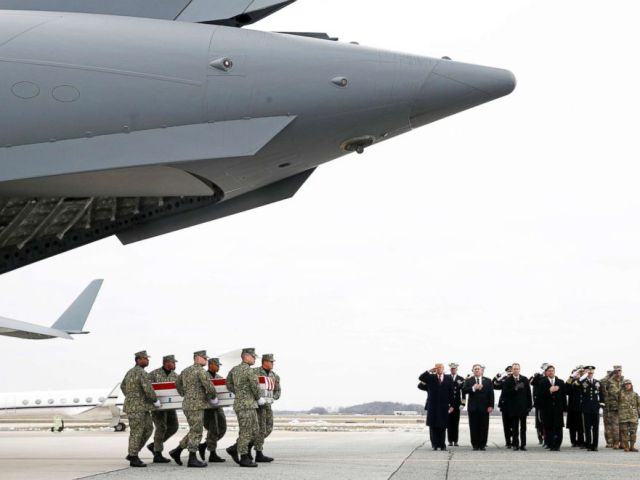 PHOTO: A U.S. Navy carry team moves a transfer case containing the remains of Scott A. Wirtz past President Donald Trump and the official party on Jan. 19, 2019, at Dover Air Force Base, Delaware.
